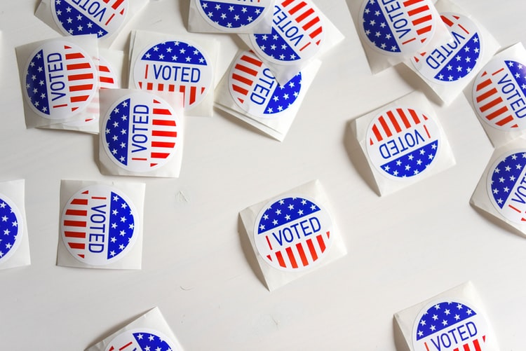 """American """"I Voted"""" stickers on white table"""